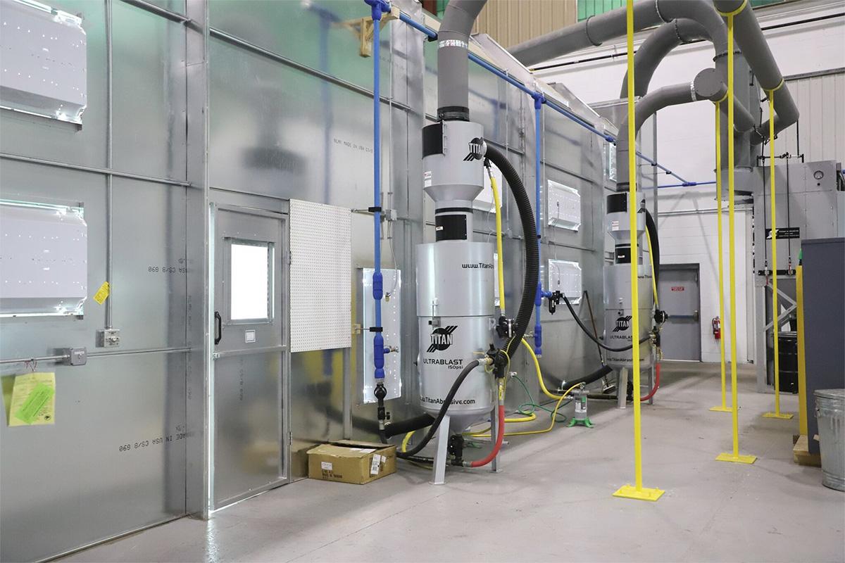 A blast room enclosure with Titan's Dual Vacuum Reclaim System.