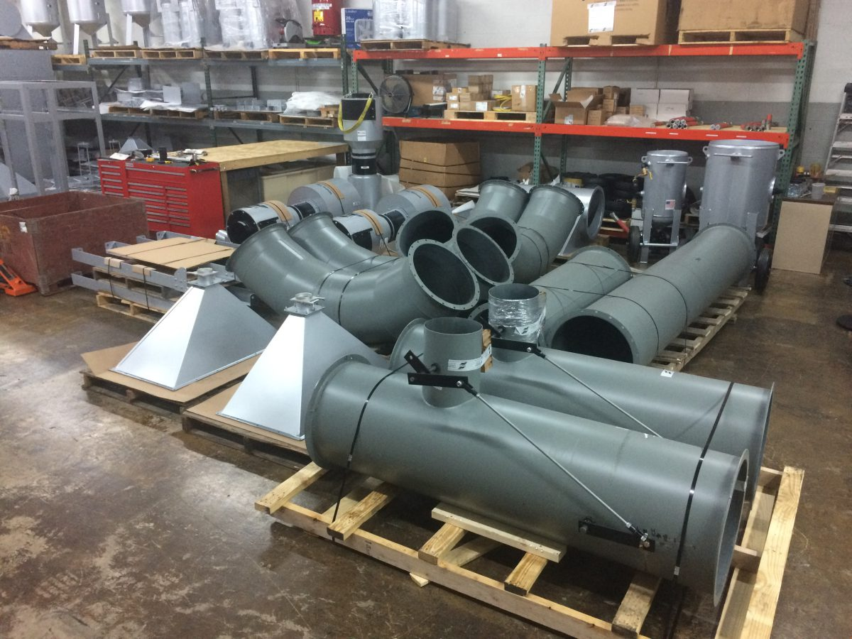Titan blast room ductwork fabricated in-house; note the thickness and diameter.]